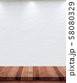 Empty wood table with white brick wall background. 58080329