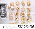 pasta with pasta ingredients on the dark wooden 58125436