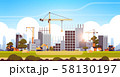 modern construction site with cranes tractor and bulldozer unfinished building exterior sunset 58130197