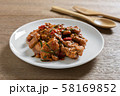 close up of stir fried chicken with red curry paste in a ceramic dish. 58169852