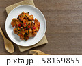 top view of stir fried chicken with red curry paste in a ceramic dish. 58169855