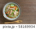 top view of stir fried japanese noodles with chicken and vegetables in a ceramic dish. 58169934