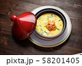 Fish soup in a pot with a red lid. catering menu 58201405