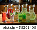 Different soft drinks in transparent jugs on a dark wooden background. menu for catering 58201408
