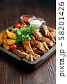 Barbecue on the bones with vegetables and potatoes . catering menu 58201426