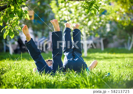 Children lying on green grass in park on a summer 58213725