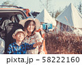 Family Posing For Selfie back to Car Packed For Road Trip 58222160