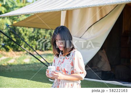 Portrait Beautiful young Asian pretty woman holding coffee mug. 58222163