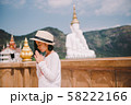 Asian woman Buddhists pay respect to the Buddha in temple. 58222166