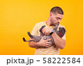 Attractive young man holding in his arms adorable cat 58222584