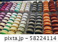 macaroon cakes of different colors on the counter 58224114
