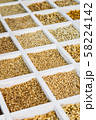 various whole and ground nuts in a wooden box 58224142