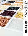 various nuts, dried fruits and berries in a wooden box 58224143