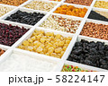 various nuts, dried fruits and berries in a wooden box 58224147