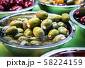 marinated and stuffed olives are on display in a store 58224159