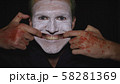 Clown Halloween man portrait. Evil clowns face. Scary smile with fingers 58281369