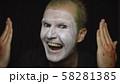 Clown Halloween man portrait. Close-up of an evil clowns face. White face makeup 58281385