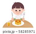 Boy eating hot cake 58285971