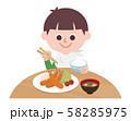 Boy eating fried shrimp set meal 58285975