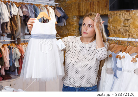 Woman shocked about high price of baby holiday dress 58372126