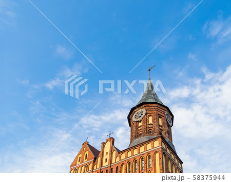Cathedral of Koenigsberg. Clock tower on blue sky background. Kaliningrad, Russia. 58375944