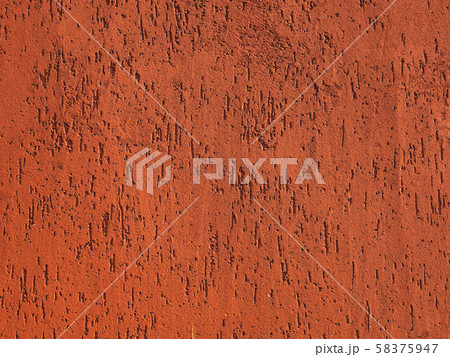Abstract orange stone background with scratches and stains. Colorful backdrop with cracks. 58375947