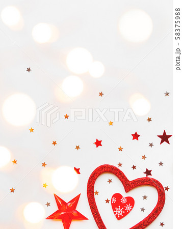 Christmas and New Year background with decorations - shiny stars, balls, snowflakes, heart, confetti and light bulbs. Place for text. 58375988