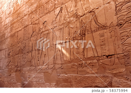 Hieroglyphs on wall of Karnak Temple Complex, famous architectural landmark in Luxor, Egypt. 58375994