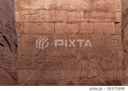Hieroglyphs on wall of Karnak Temple Complex, famous architectural landmark in Luxor, Egypt. 58375996