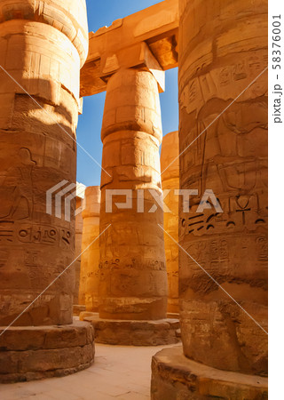 Columns in Karnak Temple Complex, famous architectural landmark in Luxor, Egypt. Pillars of the Great Hypostyle Hall from the Precinct of Amun-Re. 58376001