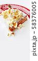 Carrot cake with popcorn sprinkles and raspberry jam. Tasty dessert on white plate. 58376005