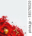 Christmas and New Year background. Bright red scarf with golden stars and confetti on white background. Folded warm accessory with copy space. 58376020