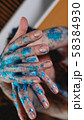 Blue glitter on woman hands. Smooth movements of the hands 58384930