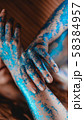 Blue glitter on woman hands. Smooth movements of the hands 58384957