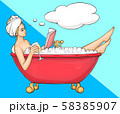 Woman having bath in bathtub with book and wine 58385907