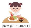 Little girl eating a fried chicken set meal 58407010