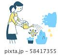 水やりをする主婦 ブルー 58417355