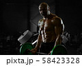 Brutal strong athletic men pumping up muscles 58423328