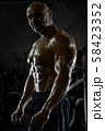 Handsome strong athletic men pumping up muscles 58423352