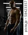 Handsome strong athletic men pumping up muscles 58423357