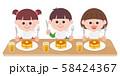 Kids eating hot cake 58424367