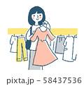 ショッピング 洋服を選ぶ女性 ピンク 58437536