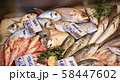 Italian fish market with many different fresh fishes 58447602