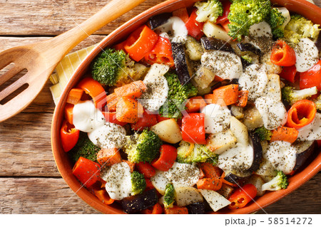 Fresh gratin of vegetables with cheese close-up in 58514272