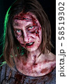 Close-up portrait of horrible zombie woman with wounds. Horror. Halloween poster. The shouting 58519302