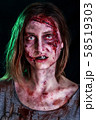Close-up portrait of horrible zombie woman with wounds. Horror. Halloween poster. The shouting 58519303
