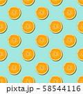 Seamless pattern of orange sliced on neo mint green color background. Minimal, flat lay. 58544116