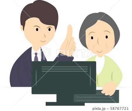 パソコン教室で学ぶシニア女性(男性講師) 58767721
