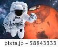 Astronaut near Mars planet in space Closeup 58843333