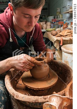 Potter at work. Workshop. 58947923